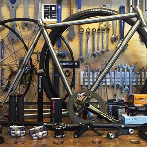 SORE Bikes workshop with a bike frame and parts